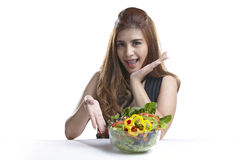 Woman presenting salad for Healthy. Asian woman attractive pretty presenting show eating salad. Portrait of beautiful smiling and happy mixed Asian brunette Stock Images