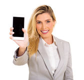 Woman presenting smart phone Royalty Free Stock Images