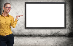 Woman presenting something on a blank screen Stock Photos