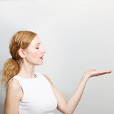 Woman presenting something on her hand Royalty Free Stock Image