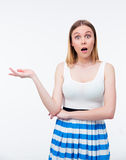Woman presenting something on the palm Stock Photos