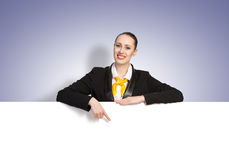 Woman presenting something Stock Images