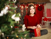 Woman with presents on background of Christmas tree and new year Stock Image