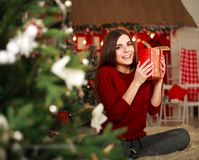 Woman with presents on background of Christmas tree and new year Royalty Free Stock Photography