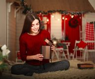 Woman with presents on background of Christmas tree and new year Royalty Free Stock Photo