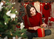 Woman with presents on background of Christmas tree and new year Stock Photography