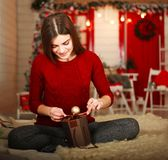 Woman with presents on background of Christmas tree and new year Royalty Free Stock Photos