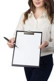 Woman presents blank clipboard Royalty Free Stock Photo