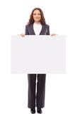 Woman presents with a blank white board Stock Photos
