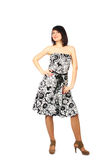 Woman presents dress. Motley full studio show Stock Photography