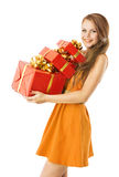 Woman Presents Gifts Boxes, Model Girl on White. Woman Holding Presents Gifts Boxes, Model Girl isolated over White Royalty Free Stock Photo