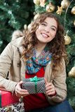 Woman With Presents Sitting Against Christmas Tree Royalty Free Stock Photos