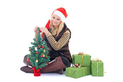 Woman with presents and tree isolated on white Royalty Free Stock Image