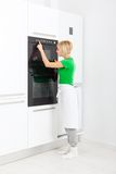 Woman press button modern kitchen appliance Royalty Free Stock Photo