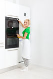 Woman press button modern kitchen appliance Royalty Free Stock Images