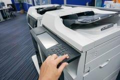 Woman press on printer manual. Press on printer manual for printing royalty free stock photo