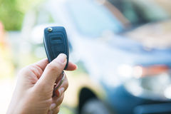 Woman pressed on the remote to open the car Stock Image