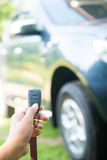 Woman pressed on the remote to open the car Stock Photo