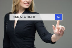 Woman presses button in the browser - find a partner. stock image