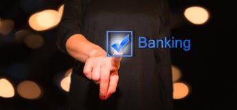Woman pressing Banking button Stock Photos