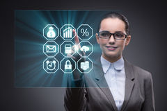 The woman pressing buttons in business concept Stock Images