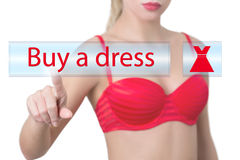 Woman pressing buy a dress button Stock Image