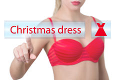 Woman pressing christmas dress button Stock Image