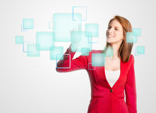 Woman pressing a digital panel Royalty Free Stock Photos