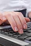 Woman pressing enter key Stock Images