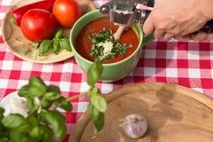 Woman is pressing garlic Royalty Free Stock Photo