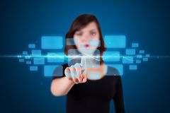 Woman pressing high tech type of modern buttons. Businesswoman pressing high tech type of modern buttons on a virtual background Stock Photos