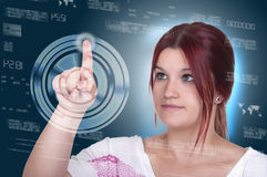 Woman pressing high tech type of modern buttons on a virtual bac Royalty Free Stock Photography