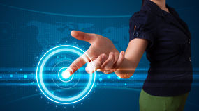Woman pressing high tech type of modern buttons Royalty Free Stock Images