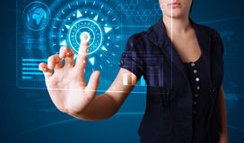 Woman pressing high tech type of modern buttons Royalty Free Stock Photo