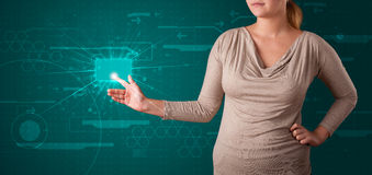 Woman pressing high tech type of modern buttons Stock Images