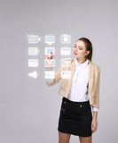 Woman pressing high tech type of modern multimedia buttons on a virtual background. Young businesswoman pressing high tech type of modern multimedia buttons on a Royalty Free Stock Images