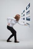Woman pressing high tech type of modern multimedia Royalty Free Stock Photo