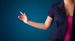 Woman pressing imaginary button Stock Photos