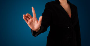 Woman pressing imaginary button Stock Image