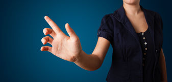 Woman pressing imaginary button Stock Images
