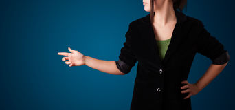 Woman pressing imaginary button Stock Photography