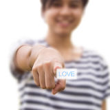Woman pressing love button Stock Image