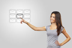 Woman pressing messaging icons Stock Photos