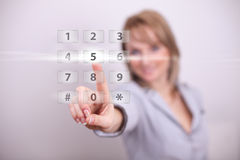 Woman pressing modern light with numbers button Royalty Free Stock Image