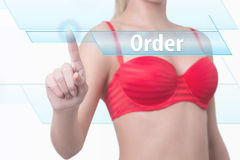 Woman pressing order button Royalty Free Stock Photo