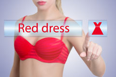 Woman pressing red dress button Royalty Free Stock Image