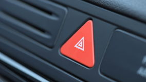 Woman pressing red triangle car hazard warning button stock video
