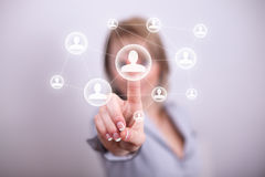 Woman pressing social media button. Woman pressing social button with one hand royalty free stock photos