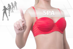 Woman pressing spa button Stock Images