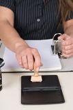 Woman is pressing a stamp at stamp pad Stock Photography